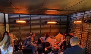 Heated outdoor lounge with Herschel California heaters